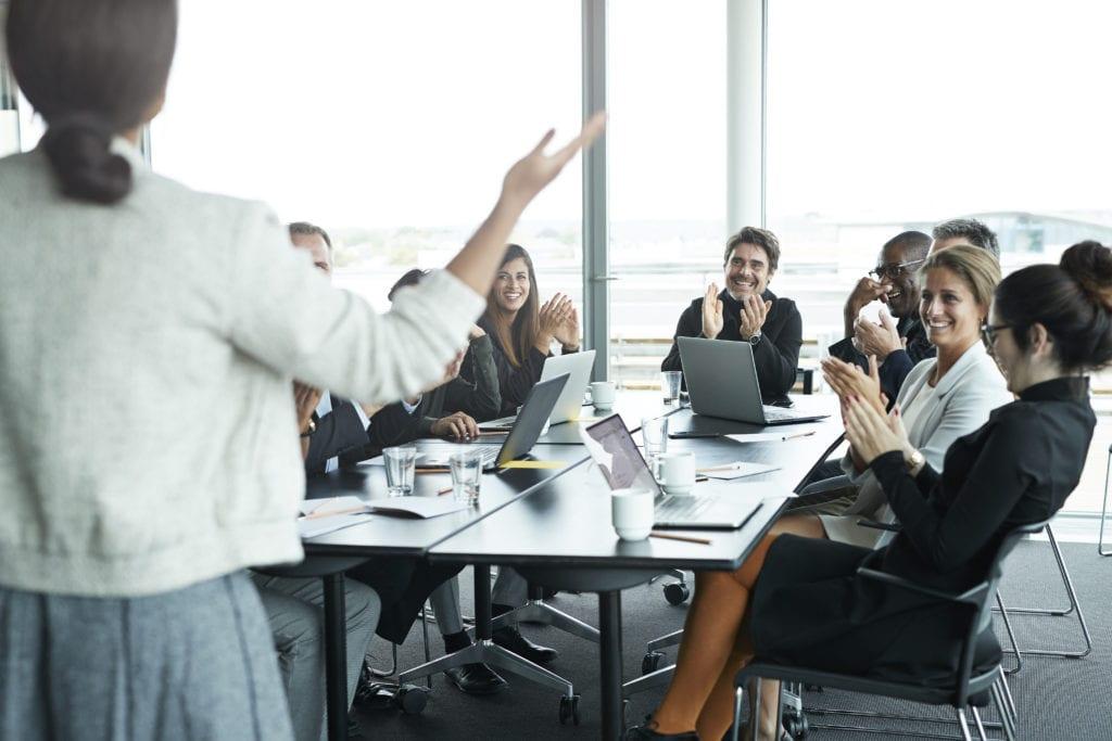 Business people in large modern meeting room