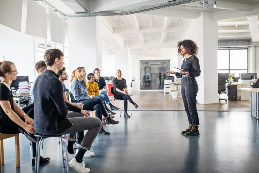 Woman addressing her team
